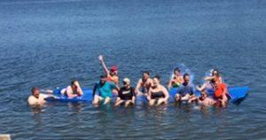 Family Playing on Water Mat at Pine Ridge Resort